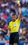 Referee Jesus Gil Manzano shows a yellow card during their La Liga match between Real Madrid and Valencia CF at the Santiago Bernabeu Stadium on 29 April 2017 in Madrid, Spain. Photo by Diego Gonzalez Souto / Power Sport Images