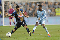 Sporting KC midfieder Peterson Joseph pushes the ball past Union's Michael Farfan..Sporting Kansas City defeated Philadelphia Union 2-1 at LIVESTRONG Sporting Park, Kansas City, KS.