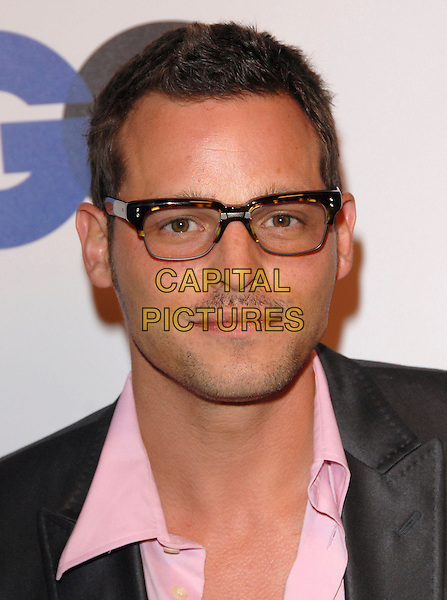 JUSTIN CHAMBERS.The 2007 GQ Men of the Year Celebration at Chateau Marmont in West Hollywood, California, USA..December 5th, 2007.headshot portrait stubble facial hair glasses .CAP/DVS.©Debbie VanStory/Capital Pictures