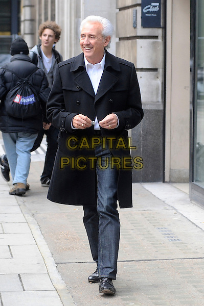 TONY CHRISTIE .Leaving BBC Radio 2, London, England, UK, 28th October 2010..full length black coat grey gray trousers blue shirt smiling .CAP/DYL.©Dylan/Capital Pictures.