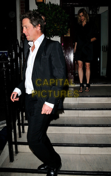 HUGH GRANT.Attending the Richard Prince Serpentine Gallery Council Dinner, Morton's restaurant, London, England, .June 23rd 2008..full length black suit white shirt leaving steps side profile.CAP/CAN.©Can Nguyen/Capital Pictures