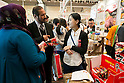 An exhibitor introduces Japanese halal products to visitors at the Japan Halal Expo 2015 on November 25, 2015, Chiba, Japan. The Japan Halal Expo 2015 is a trade show which introduces various Japanese Halal products and services held at Makuhari Messe International Convention Complex. About 100 companies and organizations attend this year's two day event aiming to make Japan more friendly to Muslim visitors. This year's main sponsor is YouCoJapan, a website which provides information for Muslim travelers to Japan and business consultation about the Muslim markets. Organizers estimated that approximately 3,280 visitors attended in 2014 and similar numbers are expected this year. In 2013, the Japan National Tourist Organisation reported that the tourists from Muslim-Majority countries including Malaysia and Indonesia increased thanks to visa relaxations, and Japan hopes to continue to attract even more. (Photo by Rodrigo Reyes Marin/AFLO)