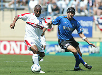 10 April 2004:  Earthquakes Ramiro Corrales battles for the ball against Chicago Fire Andy Williams at Spartan Stadium in San Jose, California.   Earthquakes and Fire are tied at halftime.