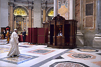 Pope Francis' receives confession during the penitential celebration in St. Peter's Basilica at the Vatican, March 29, 2019
