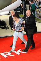 LONDON, ENGLAND - JULY 13: A punter is escorted out after trying to attack Harry Styles at the World Premiere of 'Dunkirk' at Odeon Cinema, Leicester Square on July 13, 2017 in London, England.<br /> CAP/MAR<br /> &copy;MAR/Capital Pictures /MediaPunch ***NORTH AND SOUTH AMERICAS ONLY***