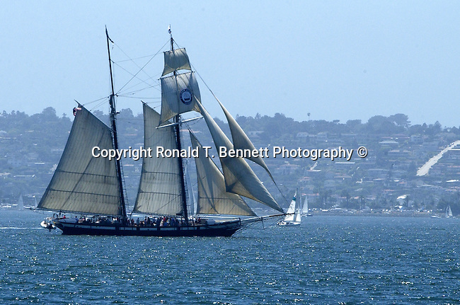 Schooner sailing the Pacific Ocean off coast of California, California Fine Art Photography by Ron Bennett, Schooner, sailing vessel, fore-and-aft sails, sails on two or more masts, forward mast shorter or same height, rear masts, schooners used by Dutch 16th 17th century, golden age of piracy, schooner popular craft for pirate, schooner has eight  more cannons, schooner is sleek and fast crew of 75, rigging,  bowsprit, jib, fore staysail, gaff topsail, foresail, main gaff topsail, mainsail, end of boom, 152 feet in length, Schooner, California Fine Art Photography by Ron Bennett (c),