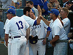 SIOUX FALLS, SD - MAY 22: Aaron Machbitz #33 from South Dakota State gets congratulated after scoring against North Dakota State in the sixth inning Thursday night in the first round of the Summit League Baseball Tournament in Sioux Falls. (Photo by Dave Eggen/Inertia)