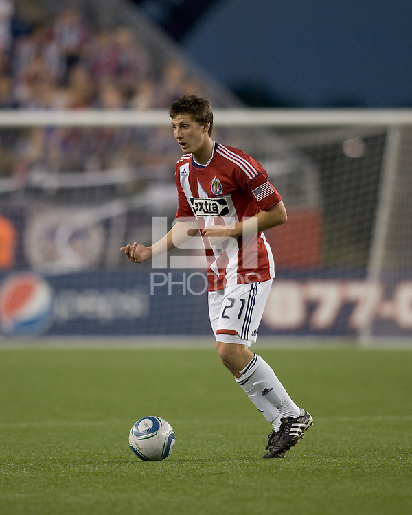 Chivas USA midfielder Ben Zemanski (21) with the ball communicates with teammate. Chivas USA defeated the New England Revolution, 4-0, at Gillette Stadium on May 5, 2010.