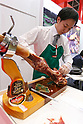 An exhibitor cuts cured ham at the Spain booth during the 42nd International Food and Beverage Exhibition (FOODEX JAPAN 2017) in Makuhari Messe International Convention Complex on March 8, 2017, Chiba, Japan. About 3,282 companies from 77 nations are participating in the Asia's largest food and beverage trade show. This year organizers expect 77,000 visitors for the four-day event, which runs until March 10. (Photo by Rodrigo Reyes Marin/AFLO)