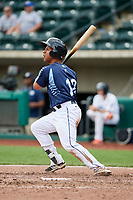 Columbus Clippers designated hitter Francisco Mejia (12) follows through on a swing during a game against the Gwinnett Stripers on May 17, 2018 at Huntington Park in Columbus, Ohio.  Gwinnett defeated Columbus 6-0.  (Mike Janes/Four Seam Images)