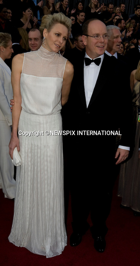 """OSCARS 2012 Prince Albert and Charlene Walk Hand in Hand at the Oscars.84th Academy Awards arrivals, Kodak Theatre, Hollywood, Los Angeles_26/02/2012.Mandatory Photo Credit: ©Dias/Newspix International..**ALL FEES PAYABLE TO: """"NEWSPIX INTERNATIONAL""""**..PHOTO CREDIT MANDATORY!!: NEWSPIX INTERNATIONAL(Failure to credit will incur a surcharge of 100% of reproduction fees)..IMMEDIATE CONFIRMATION OF USAGE REQUIRED:.Newspix International, 31 Chinnery Hill, Bishop's Stortford, ENGLAND CM23 3PS.Tel:+441279 324672  ; Fax: +441279656877.Mobile:  0777568 1153.e-mail: info@newspixinternational.co.uk"""