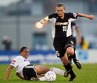 The Power's Tiffeny Milbrett gets past the tackle of Angela Hucles of the Breakers. The Boston Breakers defeated the NY Power 3-2 on 8/01/03 at Mitchel Athletic Complex, Uniondale, NY.