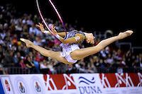 Evgeniya Kanaeva of Russia split leaps to recatch with hoop at 2009 Budapest World Cup on March 7, 2009 at Budapest, Hungary.  Photo by Tom Theobald.
