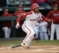 NWA Democrat-Gazette/ANDY SHUPE<br /> Arkansas second baseman Trevor Ezell heads to first after an RBI fielder's choice against Western Illinois Tuesday, March 12, 2019, during the first inning at Baum-Walker Stadium in Fayetteville. Visit nwadg.com/photos to see more photographs from the game.