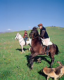 SPAIN, Andalusia, Tarifa, mature man and woman riding horse on hill