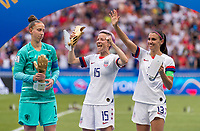 LYON,  - JULY 7: Sari van Veenendaal #1, Megan Rapinoe #15 and Alex Morgan #13 collect their trophies during a game between Netherlands and USWNT at Stade de Lyon on July 7, 2019 in Lyon, France.