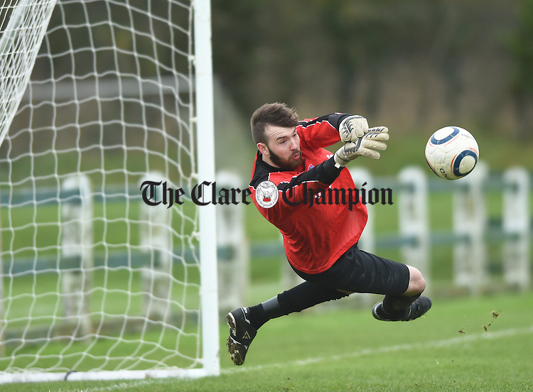 Limerick goalie Gary Neville makes a save during their FAI Oscar Traynor game against Clare in Limerick. Photograph by John Kelly.