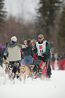 Dog Musher Sonny Lindner leaves the shoot for the 1000 mile 2003 Iditarod sled dog race from Fairbanks to Nome, Alaska . Lack of snow along the normal trail route further south forced the relocation of the restart on the Chena River in Fairbanks.