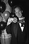 December 31, 1986:  A guest poses for a photo at Andy Warhol's  final New Year's Eve dinner at Cafe Roma restaurant in New York City, New York.  Warhol died less than two months later on February 22, 1987..