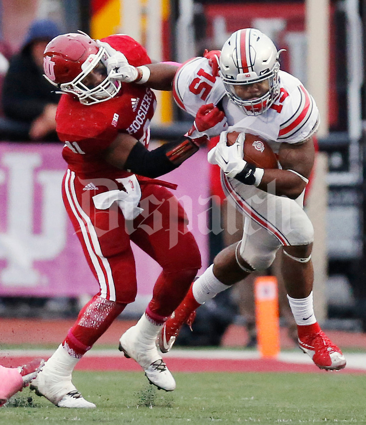 Indiana Hoosiers linebacker Clyde Newton (41) tries to tackle Ohio State Buckeyes running back Ezekiel Elliott (15)  during an NCAA football game between the Ohio State Buckeyes and the Indiana Hoosiers at Memorial Stadium in Bloomington, Indiana, on Saturday, October 3, 2015. (Columbus Dispatch photo by Fred Squillante)
