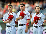 18 May 2012: Washington Nationals (left to right) Bryce Harper, Ryan Zimmerman, Danny Espinosa stand on field during the playing of the National Anthem prior to a game against the Baltimore Orioles at Nationals Park in Washington, DC. The Orioles defeated the Nationals 2-1 in the first game of their 3-game series. Mandatory Credit: Ed Wolfstein Photo