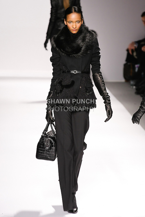Rose Cordero walks runway in an outfit from the Elie Tahari Fall 2011 collection, during Mercedes-Benz Fashion Week Fall 2011.