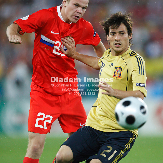 VIENNA - JUNE 26:  Aleksandr Anyukov of Russia (l) battles Spain's David Silva (r) during a UEFA Euro 2008 semi-final match June 26, 2008 at Ernst Happel Stadion in Vienna, Austria.  (Photograph by Jonathan P. Larsen)