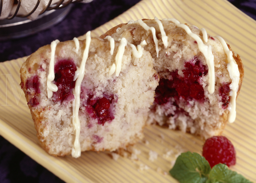 Raspberry Muffin split in half with striped white icing