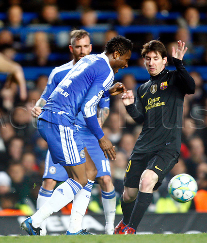 18.04.2012. Stamford Bridge, Chelsea, London. .Chelsea's Nigerian footballer John Obi Mikel  and Lionel Messi of  FC Barcelona.during the Champions League Semi Final 1st  leg match between Chelsea and Barcelona  at Stamford Bridge, Stadium on April 18, 2012 in London, England.