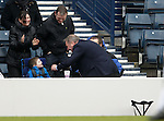 Ally McCoist climbs the wall at the end of the match to shake hands with a young supporter