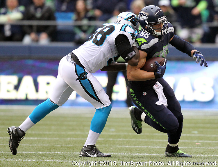 Seattle Seahawks  tight end Jimmy Graham is hit by Carolina Panthers  linebacker A.J. Klein after catching a pass from Russell Wilson at CenturyLink Field in Seattle on October 18, 2015. The Panthers came from behind with 32 seconds remaining in the 4th Quarter to beat the Seahawks 27-23.  ©2015 Jim Bryant Photography. All Rights Reserved.