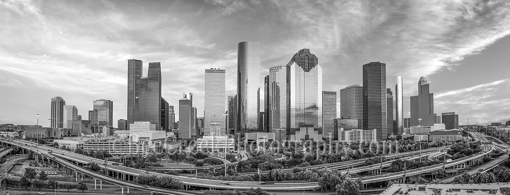 Capture this aerial panorama of Houston Skyline in black and white.  We wanted to capture downtown Houston skyline with IH45 in view so an aerial was our best option so this area of the cityscape is looking at the museum district of the city. This city is very active in the arts and culture. Houston Skyline is a small island because the overall   area is somewhere around 667 square miles.  The areas population is around 2.3 million people which makes it the fourth most populous city in the US. Houston is also the largest city in the southern united states. The skyline of Houston is very impressive site with some of the tallest and many modern skyscrapers buildings in the US. In this image you can see the Heritage Plaza, Wells Fargo and the tallest building in Houston the J P Morgan Chase Tower at 1002 ft and it the 17 tallest in the US.  We thought it was impressive as a black and white image.