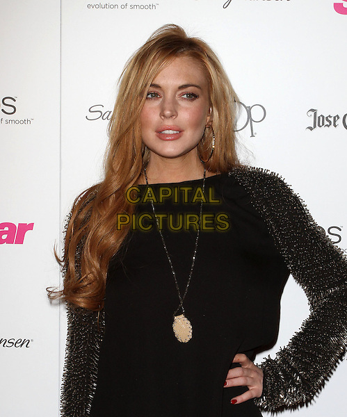 """Lindsay Lohan.Star Magazine's """"All Hollywood"""" Event With Performance By Karmin Held at AV Nightclub, Hollywood, California, USA..April 24th, 2012.half length black dress gold beads beaded sleeves spiked necklace hand on hip.CAP/ADM/KB.©Kevan Brooks/AdMedia/Capital Pictures."""