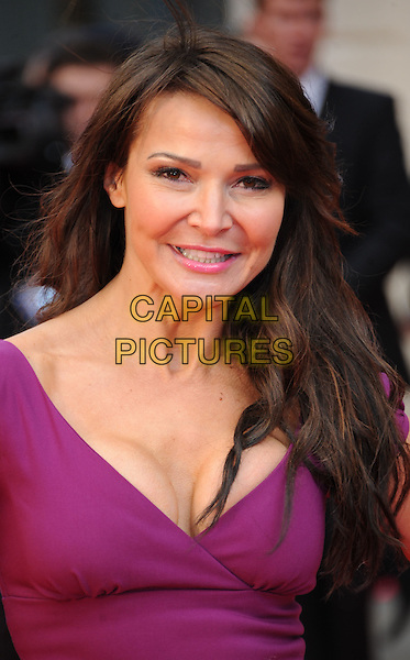 Lizzie Cundy.The Olivier Awards 2012, Royal Opera House, Covent Garden, London, England..April 15th, 2012.headshot portrait purple cleavage .CAP/WIZ.© Wizard/Capital Pictures.