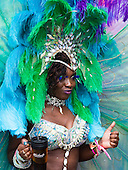 London, England. 31 August 2015. Perfomer from Bacchanalia carnival group. Performers and revellers were in good spirits despite a second years of heavy rain on the Adult Day of Notting Hill Carnival. Photo: Bettina Strenske