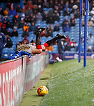 16.02.2020 Rangers v Livingston: Andy Halliday falls over the LED board at full pelt and lands on an upturned chair
