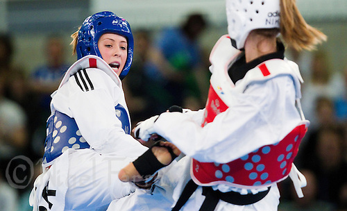 05 MAY 2012 - MANCHESTER, GBR - Jade Jones (GBR) of Great Britain (left) aims a kick at Nikita Glasnovic of Sweden during their women's -57kg category second round contest at the 2012 European Taekwondo Championships  at Sportcity in Manchester, Great Britain (PHOTO (C) 2012 NIGEL FARROW)