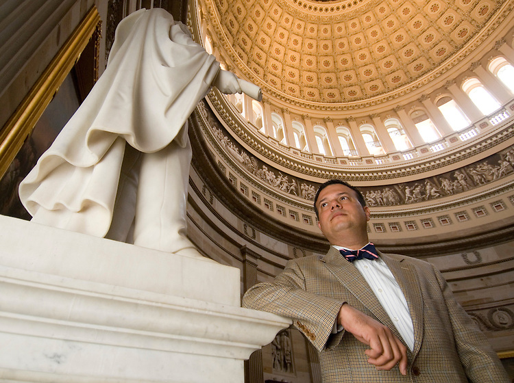 John Gonzalez, chief of staff for Rep. Melissa Bean of Illinois, poses by the statue of Lincoln in the Capitol Rotunda on Friday, Dec. 7, 2007.