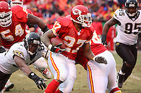 Chiefs running back Larry Johnson runs for some yardage in the first half against the Jacksonville Jaguars at Arrowhead Stadium in Kansas City, Missouri on December 31, 2006. The Chiefs won 35-30.