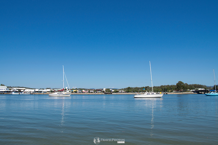 Boats anchored in the Clyde River at Batemans Bay, Australia.