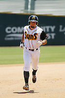 Jacksonville Suns infielder Zack Cox (20) in action during a game against the Pensacola Blue Wahoos at Bragan Field on the Baseball Grounds of Jacksonville on May 11, 2015 in Jacksonville, Florida. Jacksonville  defeated Pensacola 5-4. (Robert Gurganus/Four Seam Images)