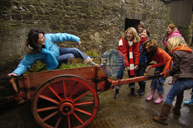 10th February, 2007. Organised hen parties (human ones) run by Deirdre Murtagh at her farm, Causey Farm, Kells, County Meath. Pauline Sharkey (Ardee, County Louth) on the car enjoying her hen with her mates on the farm.Photo: BARRY CRONIN/Newsfile.(Photo credit should read BARRY CRONIN/NEWSFILE)