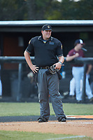 The home plate umpire between innings of the American Legion baseball game between Mooresville Post 66 and Kannapolis Post 115 at Northwest Cabarrus High School on May 30, 2019 in Concord, North Carolina. Mooresville Post 66 defeated Kannapolis Post 115 4-3. (Brian Westerholt/Four Seam Images)