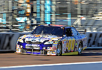 Apr 17, 2009; Avondale, AZ, USA; NASCAR Sprint Cup Series driver David Reutimann during qualifying for the Subway Fresh Fit 500 at Phoenix International Raceway. Mandatory Credit: Mark J. Rebilas-