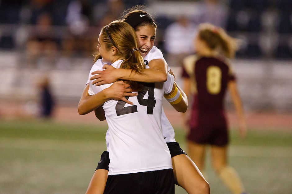 Penn's Maya Lacognato, right, and Kristina Lynch (24) celebrate a goal against Brebeuf Jesuit during the IHSAA Class 2A Girls Soccer State Championship Game on Saturday, Oct. 29, 2016, at Carroll Stadium in Indianapolis. Special to the Tribune/JAMES BROSHER