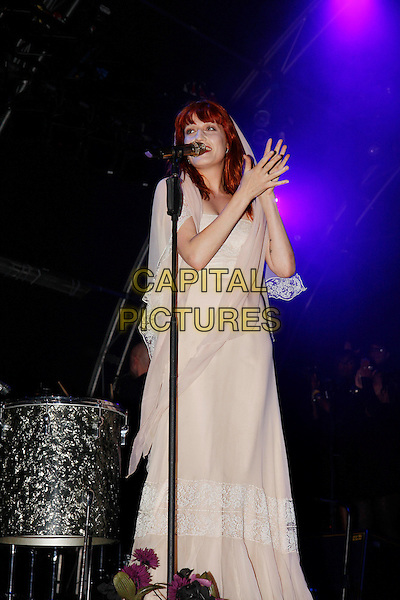 FLORENCE WELCH.Florence and The Machine perform live at Somerset House, London, England..July 15th, 2010.stage concert live gig performance music full length white dress singing hands sheer.CAP/MAR.© Martin Harris/Capital Pictures.