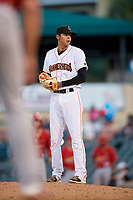 Jupiter Hammerheads relief pitcher Jorgan Cavanerio (18) gets ready to deliver a pitch during a game against the Palm Beach Cardinals on August 4, 2018 at Roger Dean Chevrolet Stadium in Jupiter, Florida.  Palm Beach defeated Jupiter 7-6.  (Mike Janes/Four Seam Images)