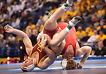 March 21 2009      Craig Brester (red, at right) from Nebraska battles Jake Varner (maroon) from Iowa State in the 197 pound weight class in the championship round of the NCAA Division I  Wrestling Championships which were held March 19 through March 21, 2009 at the Scottrade Center in downtown St. Louis, Missouri.  ..         *******EDITORIAL USE ONLY*******