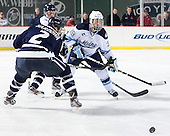 Connor Hardowa (UNH - 2) (Kipp), Joey Diamond (Maine - 39) - The University of Maine Black Bears defeated the University of New Hampshire Wildcats 5-4 in overtime on Saturday, January 7, 2012, at Fenway Park in Boston, Massachusetts.