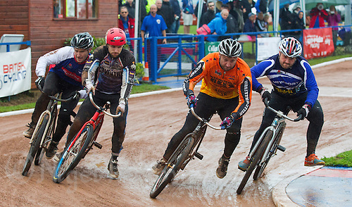 31 AUG 2015 - IPSWICH, GBR - Adam Peck (left) of Ipswich and Myke Grimes (second from the left) of Coventry, and Lee Aris (second from the right) of Wednesfield and Nicky Evans (right) of Newport battle for position during a heat at the British Cycle Speedway Championships at Whitton Sports and Community Centre in Ipswich, Suffolk, Great Britain (PHOTO COPYRIGHT © 2015 NIGEL FARROW, ALL RIGHTS RESERVED)